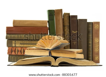 Old antique books isolated on white background