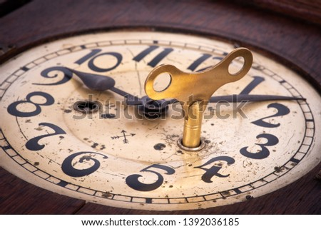 Old antique clock with key winder close-up #1392036185