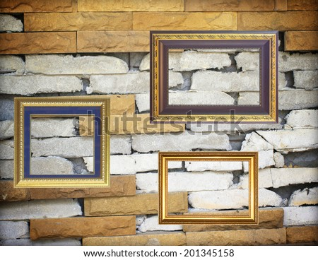 Old antique gold picture frame wall stone walls.