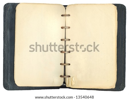 Old antique notebook with blank yellowed pages empty for your own text.