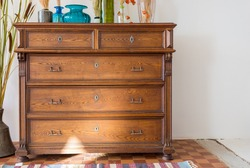 old antique old mahogany chest of drawers in a room with additional decor