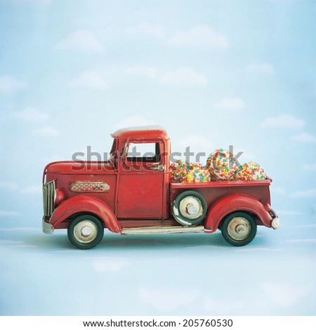 Old antique toy truck carrying sweet candy #205760530