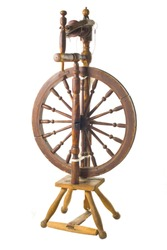 Old antique vintage traditional spinning-wheel,a distaff of the 19th century isolated on white background. Russia.