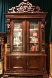 Old antique vintage wooden bookcase with books.