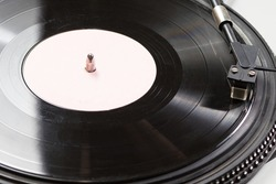 Old antique vinyl record for playing a melody on a gramophone music player. With place for text.