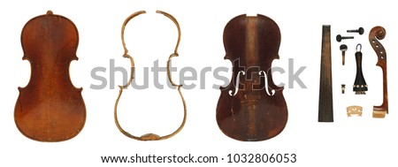 Old antique violin disassembled and all parts are laid out in order: body, back and front plates, ribs, blocks, bridge, scroll, peg, head, shaft, fingerboard, button, tailpiece, neck.