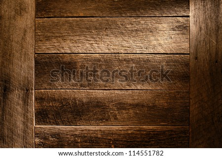 Old antique wood board plank grunge background built with aged and weathered vintage barn wood featuring worn grain and texture