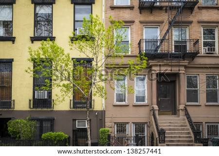 Old apartment building with fire escapes, Manhattan, New York City