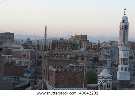 Old arab city with mosque tower - stock photo