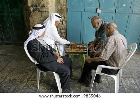 old arab men playing backgammon, old city, jerusalem, israel