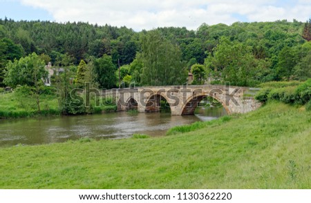 Old arched stone bridge across the River Derwent at Kirkham, North Yorkshire, England