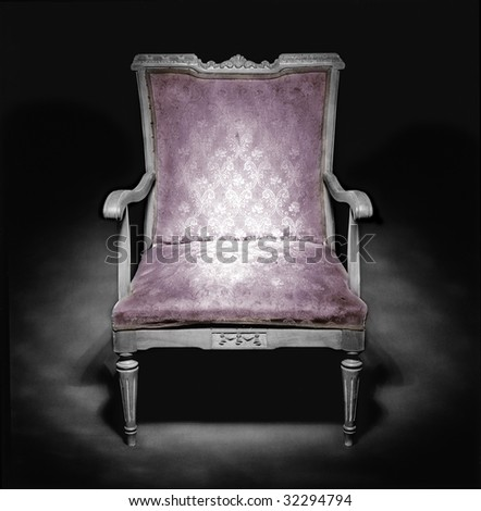 Old armchair in a dark ambiance