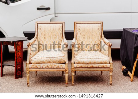 Old armchairs at the flea market in Goxwiller, Alsace, France