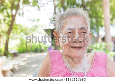 old Asian female on nature background, she feeling happy and smile, elderly happiness #1192117693