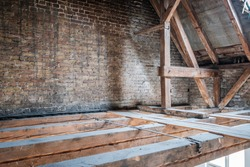 old attic / loft during dry rot renovation,  wooden roof frame
