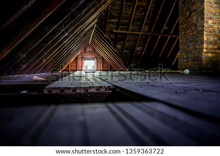 Old attic space with roof rafters and a window, shallow focus on wooden floor Stock photo ©