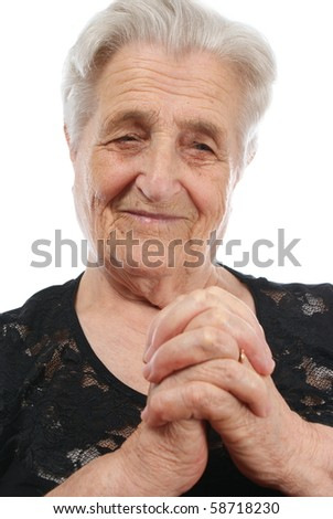 Old, attractive Caucasian woman praying