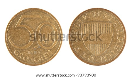 Old Austrian 50 Groschen coins on the white background (1989 year) - stock photo