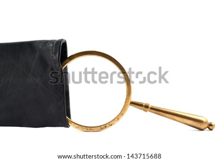 Old authentic magnifying glass in a black leather case against the white background