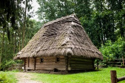 Old authentic wooden house with a thatched roof