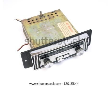 Old auto radio isolated on white.