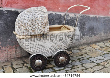 old baby carriage on street