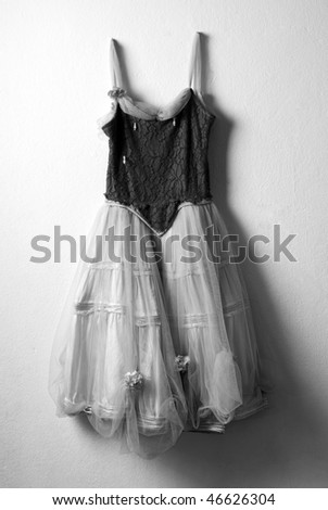 Old ballet dress hanged on the wall