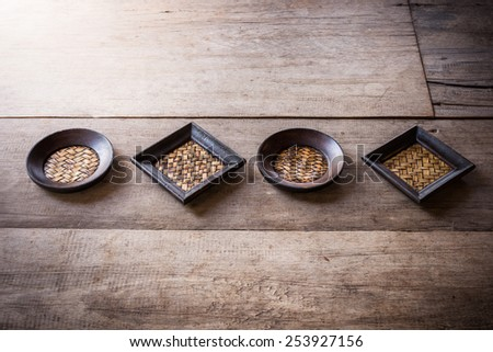 old bamboo square and circle coaster on wooden table background
