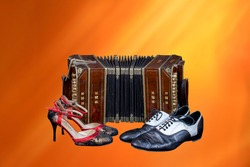 Old bandoneon with tango shoes