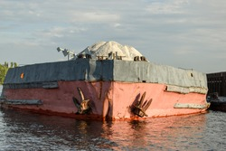 Old barge with rubble, front view