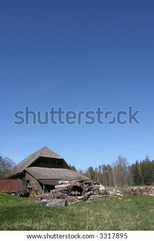 Old barn against the blue sky