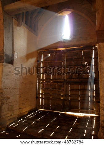 Old Barn Doors With Light Rays Coming Through Stock Photo