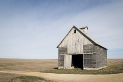 Old Barn on the Corner of a Harvested Field with a Dirt Road