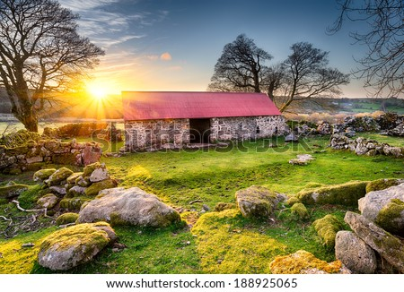 old barn or croft with a red...