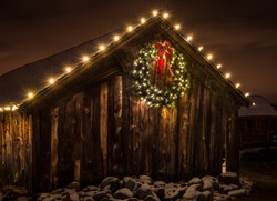 Old Barn with Lighted Christmas Holiday Wreath