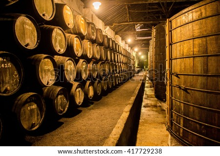 Old Barrels in the wine cellar, Porto, Portugal