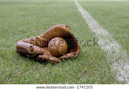 Old Baseball Glove and Ball Beside Foul Line