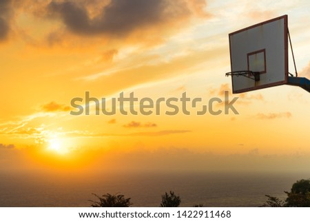 Old basketball board with basket hoop against sunset sky. Sport, recreation. #1422911468