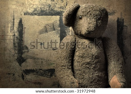 Old bear on the wood background