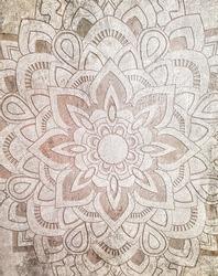 old beige ceramic tile with floral mandala pattern