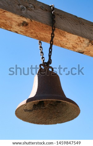 Old bell hangs on gallows