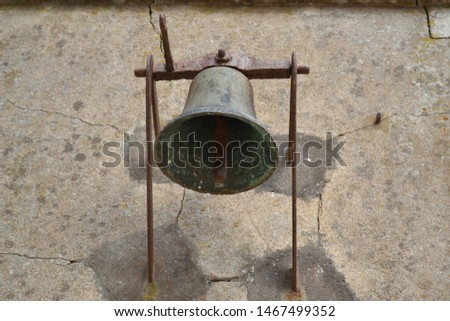 old bell on an old wall
