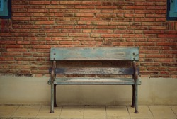 Old benches are placed in public areas.