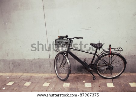 Old Bicycle against a Wall