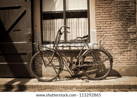 old bicycle against the wall