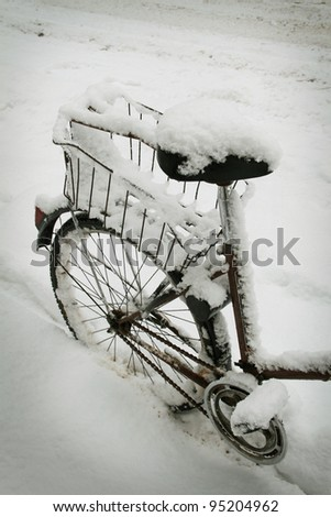Old bicycle in winter - stock photo