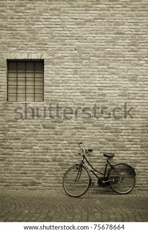 old  bicycle leaning on a wall  ...