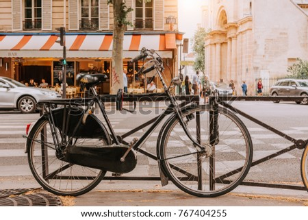 Old bicycle parked on Boulevard Saint-Germain in Paris, France. Architecture and landmarks of Paris. Postcard of Paris