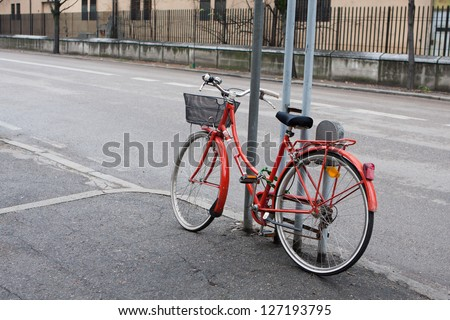 Old bicycle parked on the street