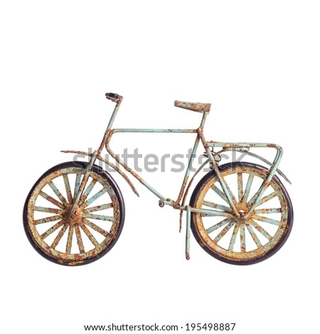 old bicycle toy isolated on...